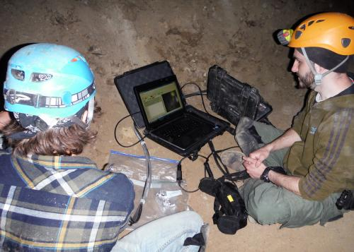 NMSU graduate students Kyle Uckert, astronomy, and Ivan Dragulin, engineering, set up the Portable AOTF Spectrometer for Astrobiology inside Fort Stanton Cave. (Courtesy photo)